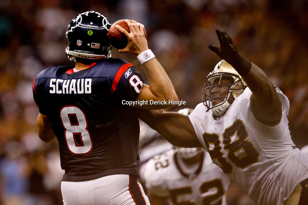 August 21, 2010; New Orleans, LA, USA; New Orleans Saints defensive tackle Sedrick Ellis (98) goes in for a sack against Houston Texans quarterback Matt Schaub (8) during the first quarter of a preseason game at the Louisiana Superdome. Mandatory Credit: Derick E. Hingle