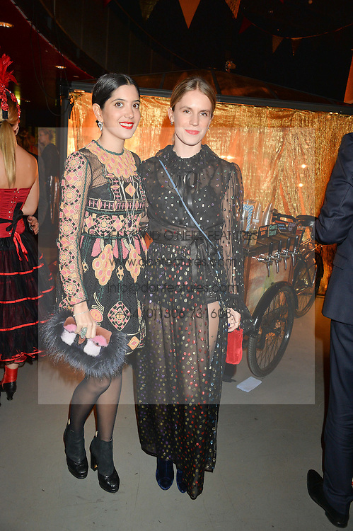 Left to right, NOOR FARES and EUGENIE NIARCHOS at 'The World's First Fabulous Fund Fair' in aid of the Naked Heart Foundation hosted by Natalia Vodianova and Karlie Kloss at The Roundhouse, Chalk Farm Road, London on 24th February 2015.