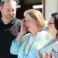 "Donna Clingan, center, of Pontotoc, wipes away tears as she stands with her son Matthew and daughter-in-law Brandy Clingan, as the announcement is made of Donna being awarded a 2009 Toyota Camry Friday morning at McCord's Auto Service in Belden. NAPA AutoCare Center of Northeast Missisippi hosted the ""mother"" of all giveaways in celebration of mom this Mother's Day. Donna was nominated by her daughter-in-law Brandy Clingan who wrote a short survey describing Donna's selfless contribution to her community and family."