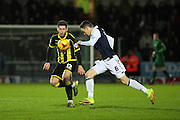 Millwall FC midfielder Shaun Williams heads the ball clear from Burton Albion midfielder Calum Butcher during the Sky Bet League 1 match between Burton Albion and Millwall at the Pirelli Stadium, Burton upon Trent, England on 1 December 2015. Photo by Aaron Lupton.