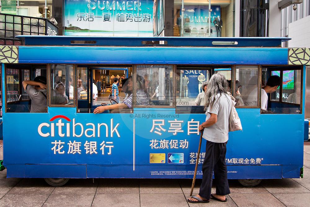 Beggar on Nanjing East Road in Shanghai, China.