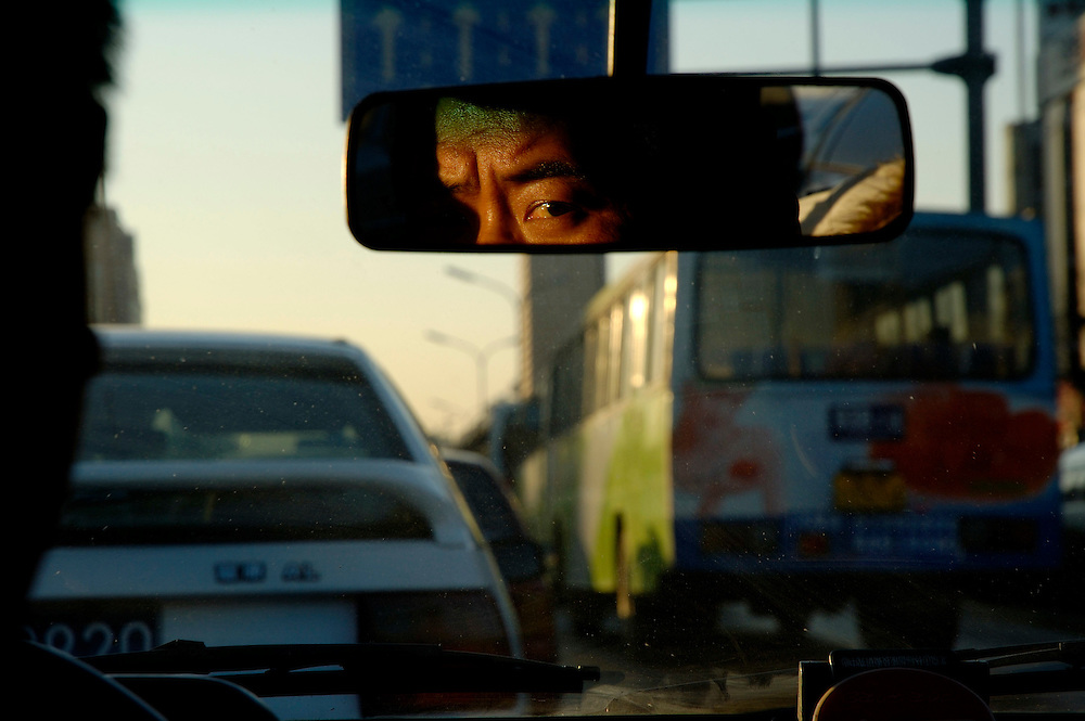 Taxi driver stuck in a rush hour  traffic jam on Jiangguomen Wai...From China [sur]real © Mark Henley..