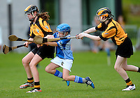 20 Aug 2016:  Alisha Quinn, Galway, in action against Katie Bookle, left, and Leah Hanrahan, Kilkenny.  Camogie U14.  2016 Community Games National Festival.  Athlone Institute of Technology, Athlone, Co. Westmeath. Picture: Caroline Quinn