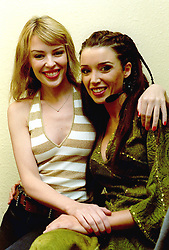 Embargoed to 0001 Monday May 28 File photo dated 13/2/2001 of Kylie Minogue (left) visits her sister Dannii in her dressing room prior to Dannii's opening night appearance as Esmeralda in the Musical Notre Dame De Paris at the Dominion Theatre in London. The pop star and actress turns 50 on Monday.