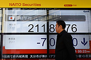 A man looks at an electronic stock board of a securities firm in Tokyo, Friday, Feb. 9, 2018. Asian shares have opened lower and are tracking the overnight plunge on Wall Street. The Dow Jones industrial average plunged more than 1,000 points as a weeklong market swoon continued.09/02/2018-Tokyo, JAPAN