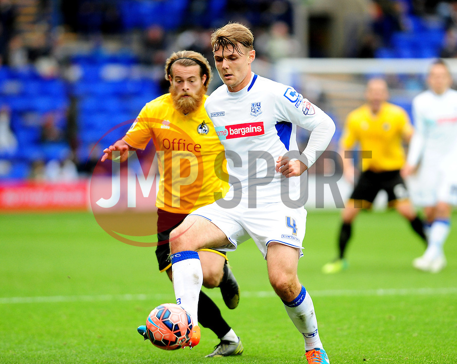 Tranmere Rovers's Max Power holds off Bristol Rovers' Stuart Sinclair - Photo mandatory by-line: Neil Brookman/JMP - Mobile: 07966 386802 - 08/11/2014 - SPORT - Football - Birkenhead - Prenton Park - Tranmere Rovers v Bristol Rovers - FA Cup - Round One