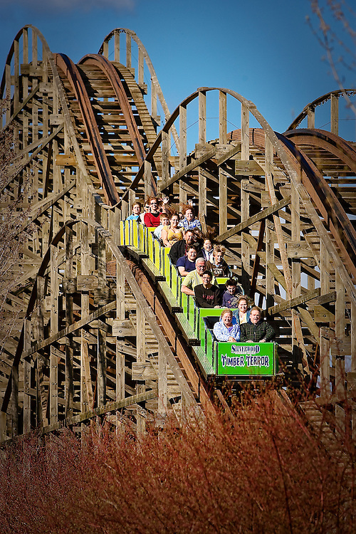 JEROME A. POLLOS/Press..Visitors to Silverwood Theme Park speed down the track of Timber Terror during a community event at the attraction May 9.