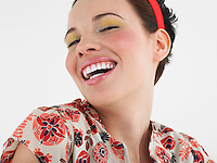 Woman laughing head and shoulders in studio