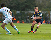 Highlanders player Josh Renton grabs the ball free.Rugby union match The Highlanders vs French team Racing 92
