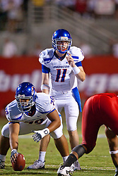 Sep. 18, 2009; Fresno, CA, USA; Boise State Broncos quarterback Kellen Moore (11) stands behind the line of scrimmage before a play against the Fresno State Bulldogs during the second quarter at Bulldog Stadium.  Mandatory Credit: Jason O. Watson-US PRESSWIRE