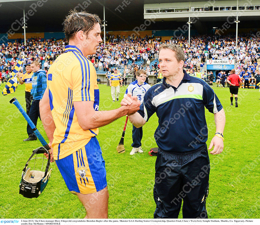2 June 2013; The Clare manager Davy Fitzgerald congratulates Brendan Bugler after the game. Munster GAA Hurling Senior Championship, Quarter-Final, Clare v Waterford, Semple Stadium, Thurles, Co. Tipperary. Picture credit: Ray McManus / SPORTSFILE