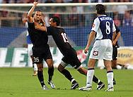 n/z.: strzelec gola dla Polonii Dariusz Dzwigala (nr35-Polonia) , Pawel Sasin (nr15-Polonia) , Tomasz Iwan (nr8-Lech) podczas meczu ligowego Lech Poznan (biale-niebieskie) - Polonia Warszawa (czarne) , I liga polska , 1 kolejka sezon 2005/2006 , pilka nozna , Polska , Poznan , 26-07-2005 , fot.: Adam Nurkiewicz / mediasport....Dariusz Dzwigala (nr35-Polonia) scored goal for Polonia and  Pawel Sasin (nr15-Polonia) celebrates and Tomasz Iwan (nr8-Lech) during Polish league first division soccer match in Poznan. July 26, 2005 ; Lech Poznan (white-blue) - Polonia Warszaw (black) ; first division , 1 round season 2005/2006 , football , Poland , Poznan ( Photo by Adam Nurkiewicz / mediasport )
