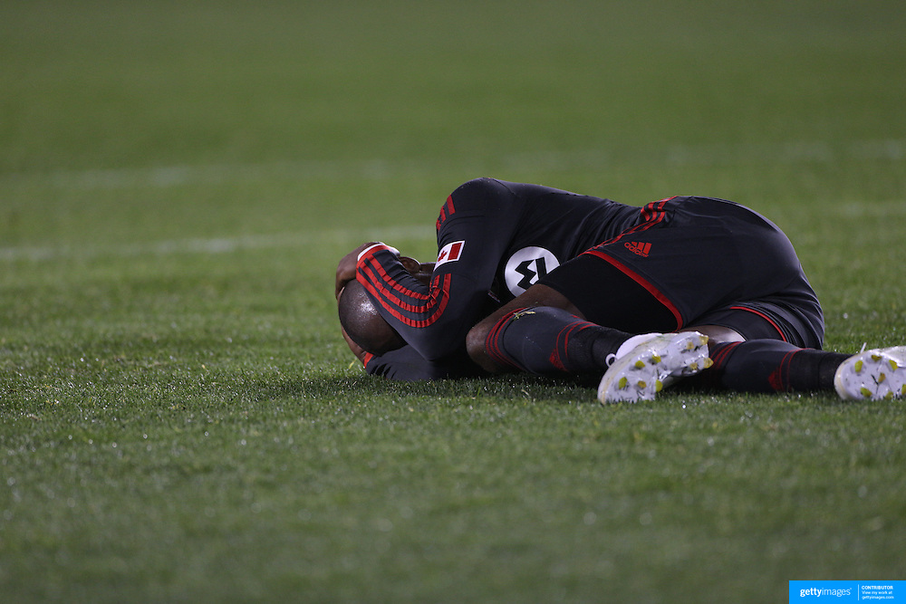 Jackson, Toronto FC, lies on the ground after clashing heads with Jamison Olave, New York Red Bulls, while challenging for a ball during the New York Red Bulls Vs Toronto FC, Major League Soccer regular season match at Red Bull Arena, Harrison, New Jersey. USA. 11th October 2014. Photo Tim Clayton