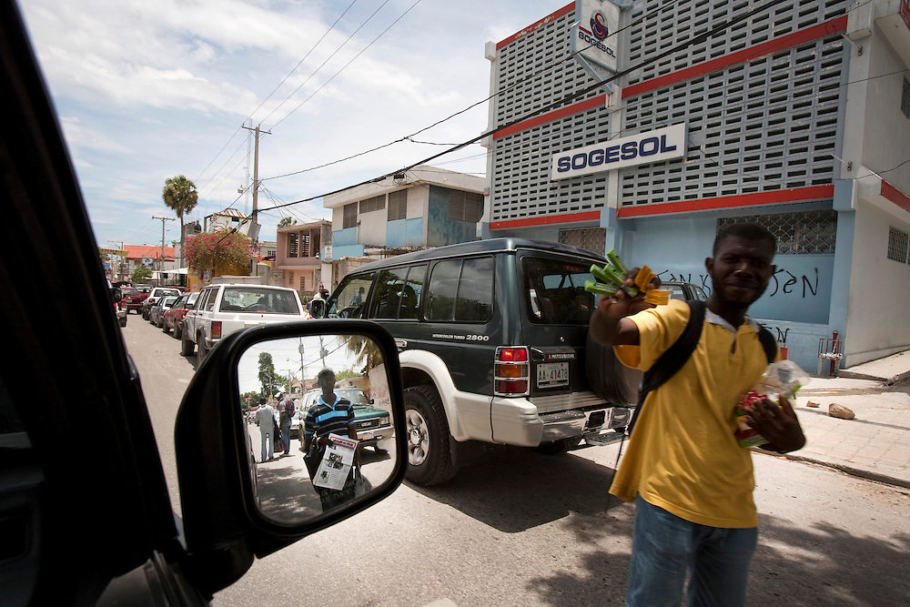 A man selling food in Port-au-Prince, Haiti on July 15, 2010. The camp is estimated to have over 50,000 refugees. <br /> Six month after a catastrophic earthquake measuring 7.3 on the Richter scale hit Haiti on January 13, 2010, killing an estimated 230,000 people, injuring an estimated 300,000 and making homeless an estimated 1,000,000.