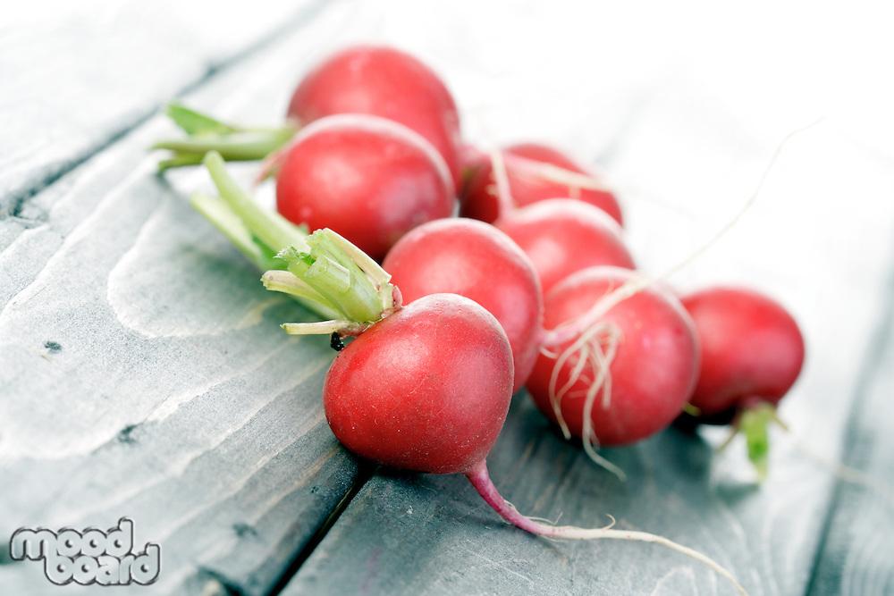 Studio shot of radish on wooden table