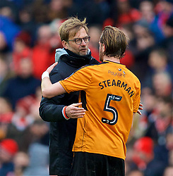 LIVERPOOL, ENGLAND - Saturday, January 28, 2017: Liverpool's manager Jürgen Klopp hugs Wolverhampton Wanderers' goalscorer Richard Stearman after losing 2-1 during the FA Cup 4th Round match at Anfield. (Pic by David Rawcliffe/Propaganda)