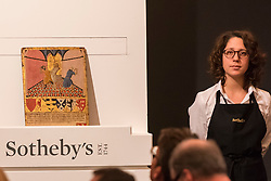 "© Licensed to London News Pictures. 07/12/2016. London, UK. ""The Flagellation"" by Master of the Osservanza which sold for a hammer price of GBP1.15m (est, GBP400-600k), at the Old Masters Evening Sale at Sotheby's in New Bond Street. Photo credit : Stephen Chung/LNP"