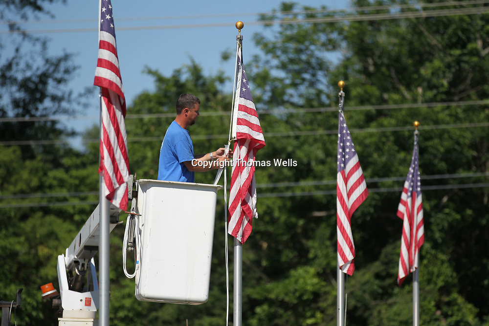 Tupelo Park and Recreation employee Philip Crowe finishes up replacing all the ropes to the American flags that line the road through Veterans Park Monday morning. Crowe is getting the poles ready for a new shipment of flag that are donated from Woodman of the World and will replace all the flags that are used at the park.