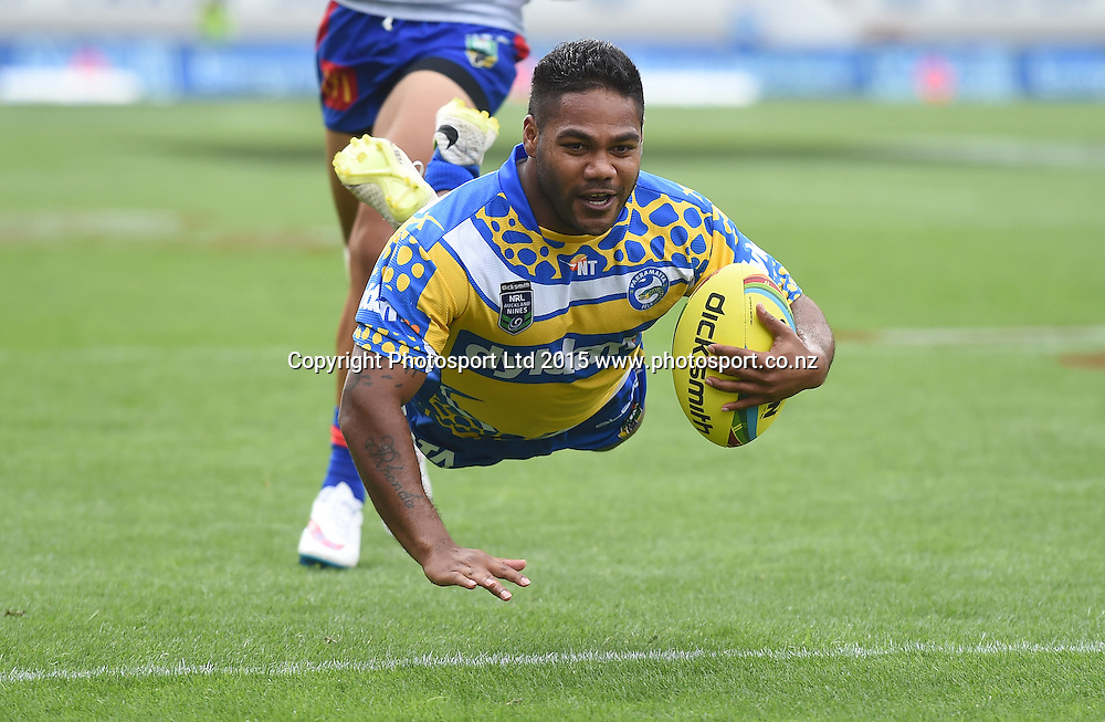 Parramatta's Chris Sandow scores a try against Newcastle during play on Day 1 of the NRL Auckland Nines Rugby League Tournament, Eden Park, Auckland, New Zealand. Saturday 31 January 2015. Copyright Photo: Andrew Cornaga/www.Photosport.co.nz