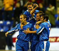 Photo. Aidan Ellis.<br />Wigan Athletic v Stoke City.<br />Nationwide Division 1.<br />14/10/2003.<br />Wigan's Geoff Horsfield is mobbed by team mates after equalsing for his team.