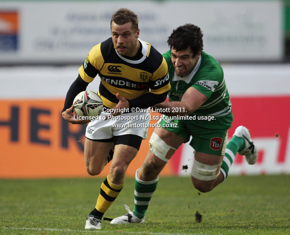 Taranaki's Tyson Keats tries to beat Nick Crosswell. ITM Cup rugby - Manawatu Turbos v Taranaki at FMG Stadium, Palmerston North, New Zealand on Saturday, 6 August 2011. Photo: Dave Lintott / photosport.co.nz
