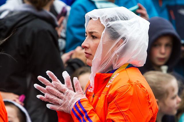 spectator prepared for the rain awaits start in Hopkinton