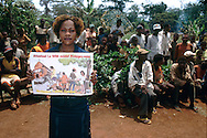 Part of the WWF Jengi project in South-East Cameroon,  a Health Education officer in Salapumbe is informing the local communities, mainly Baka people, of health issues conected with AIDS and malaria.