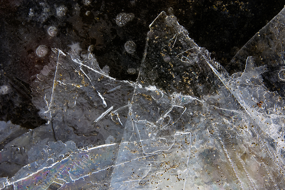 The broken shards of ice along Jackson Lake mimic the shapes of the Tetons in Grand Teton National Park, Wyoming.