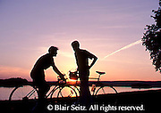 Active Aging Senior Citizens, Retired, Activities, Elderly Couple Outdoor Recreation, Staying Fit, Enjoying Nature, Aged Couple with Bicycles, Sunset, Romantic Couples, Staying Young