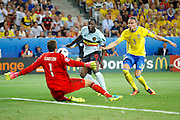 Sweden Goalkeeper Andreas Isaksson (1) saves a shot from Belgium forward Romelu Lukaku (9)  during the Euro 2016 match between Sweden and Belgium at Stade de Nice, Nice, France on 22 June 2016. Photo by Andy Walter.