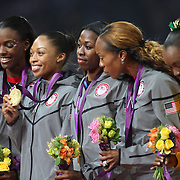 The USA Women's 4 x 400 relay team of DeeDee Trotter, Allyson Felix, Francena McCorory and Sanya Richards-Ross winning the Gold Medal at the Olympic Stadium, Olympic Park, during the London 2012 Olympic games. London, UK. 11th August 2012. Photo Tim Clayton
