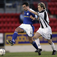 St Johnstone v St Mirren..18.12.04<br />David Hannah is tracked by Mark Reilly<br /><br />Picture by Graeme Hart.<br />Copyright Perthshire Picture Agency<br />Tel: 01738 623350  Mobile: 07990 594431