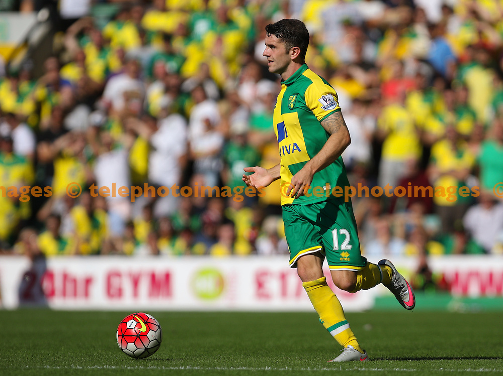 Robbie Brady of Norwich City on the ball during the Barclays Premier League match between Norwich City and Stoke City at Carrow Road in Norwich. August 22, 2015.<br /> Arron Gent / Telephoto Images<br /> +44 7967 642437