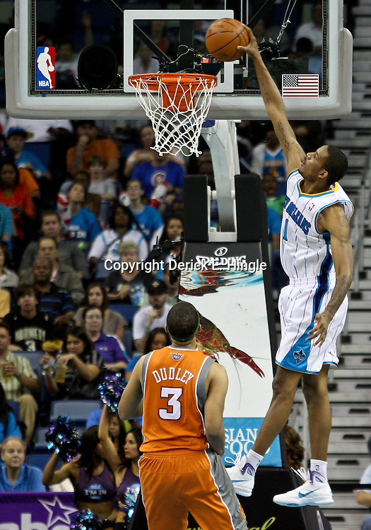 April 8, 2011; New Orleans, LA, USA; New Orleans Hornets small forward Trevor Ariza (1) dunks over Phoenix Suns small forward Jared Dudley (3) during the third quarter at the New Orleans Arena. The Hornets defeated the Suns 109-97.  Mandatory Credit: Derick E. Hingle