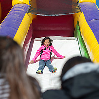 100214      Cayla Nimmo<br /> <br /> Zierra Willie takes her turn down the inflatable slide during children's day Thursday afternoon at the Northern Navajo Nation Fair in Shiprock.