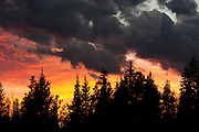 USA, Yellowstone National Park (WY).Red sunset on a stormy day at West Thumb Geyser Basin