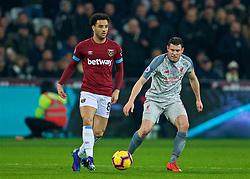 LONDON, ENGLAND - Monday, February 4, 2019: West Ham United's Felipe Anderson and Liverpool's captain James Milner during the FA Premier League match between West Ham United FC and Liverpool FC at the London Stadium. (Pic by David Rawcliffe/Propaganda)
