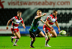 Gloucester Inside Centre (#12) Tim Molenaar chases the ball against Ospreys Outside Centre (#13) Ben John during the first half of the match - Photo mandatory by-line: Rogan Thomson/JMP - Tel: Mobile: 07966 386802 09/11/2012 - SPORT - RUGBY - Liberty Stadium - Swansea. Ospreys v Gloucester - LV= Cup