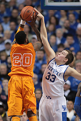 UK forward Kyle Wiltjer, right, contests a shot by Tennessee forward Kenny Hall in the second half. The University of Kentucky Men's Basketball team hosted University of Tennessee , Tuesday, Jan. 15, 2013 at Rupp Arena in Lexington . Photo by Jonathan Palmer/Special to the Courier-Journal