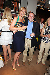 SANTA SEBAG-MONTEFIORE and ANDREW ROBERTS at a party to celebrate the publication of Sashenka by Simon Sebag-Montefiore held at Asprey, Bond Street, London on 1st July 2008.<br /><br />NON EXCLUSIVE - WORLD RIGHTS