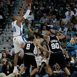 29 March 2009: New Orleans Hornets forward David West (30) shoots over San Antonio Spurs center Drew Gooden (90) and guard Tony Parker (9) during a 90-86 victory by the New Orleans Hornets over Southwestern Division rivals the San Antonio Spurs at the New Orleans Arena in New Orleans, Louisiana.