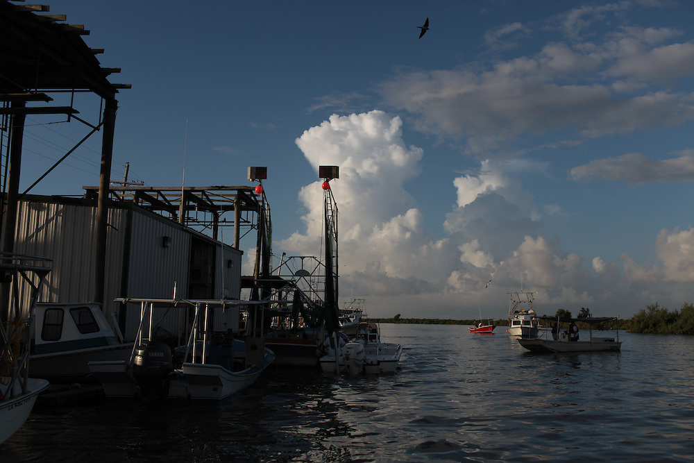 Fishermen head out of Delacroix, LA to pull up contaminated soft boom on July 20, 2010.