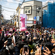 KAWASAKI, JAPAN - APRIL 2 : People take photos of a large pink phallus shaped portable shrine during the annual Kanamara Festival on April 2, 2017 in Kawasaki, Japan. The fertility festival, originated from prostitutes who wished to pray for good business and protection from sexually transmitted diseases, nowadays, celebrates for fertility, relationships and safe sex practices, including AIDS prevention. Attracted with Tens of thousands festival goers including tourist, people can buy penis shape candies, key chains, trinkets, pens, chocolates and even toy glasses with a plastic penis nose. (Photo by Richard Atrero de Guzman/NUR Photo)