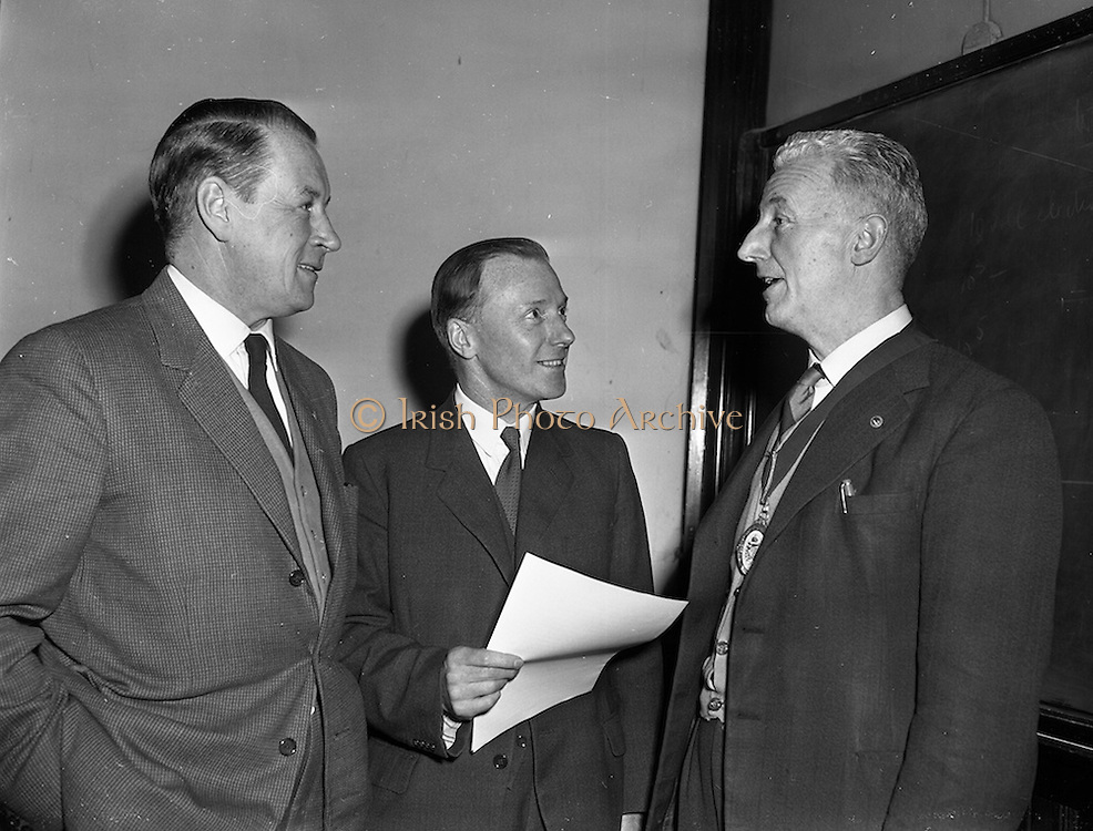 """09/03/1959<br /> 03/09/1959<br /> 09 March 1959<br /> Lecture by Mr. S.E. Holmes on """"Modern Lubricants and Additives"""" at Trinity College, Dublin. Mr. S.E. Holmes, A.R.I.C., A.F.I.N.S.P. of C.C. Wakefield, London, Delivered a lecture entitled """"Modern Lubricants and Additives"""" to members of the Engineering and Scientific Association of Ireland at the Physics Laboratory, Trinity College. Picture shows Mr. Holmes (centre) chatting to Mr. J.C. Tonge, (right), President of the Engineering and Scientific Association of Ireland and Mr. W.J. Boyle, Assistant Secretary of the Association, before the address."""