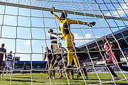Swansea City goalkeeper Kristoffer Nordfeldt (1) tips the ball over the bar during the EFL Sky Bet Championship match between Queens Park Rangers and Swansea City at the Loftus Road Stadium, London, England on 13 April 2019.