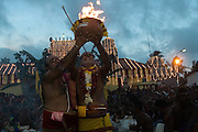 Sri Lanka. Udappuwa. On the dawn of the day of the fire walking, the chief priest brings out from the Hindu Temple a pot of 'Sacred Fire' that will kindle the wood pyre.