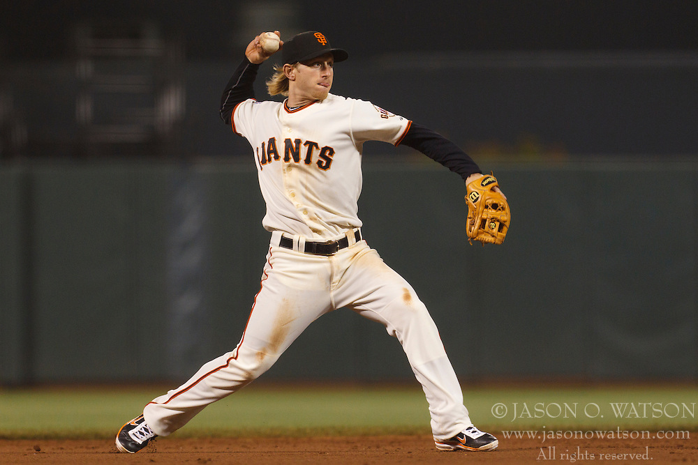 August 30, 2011; San Francisco, CA, USA;  San Francisco Giants shortstop Mike Fontenot (14) throws to first base against the Chicago Cubs during the ninth inning at AT&T Park. Chicago defeated San Francisco 5-2.