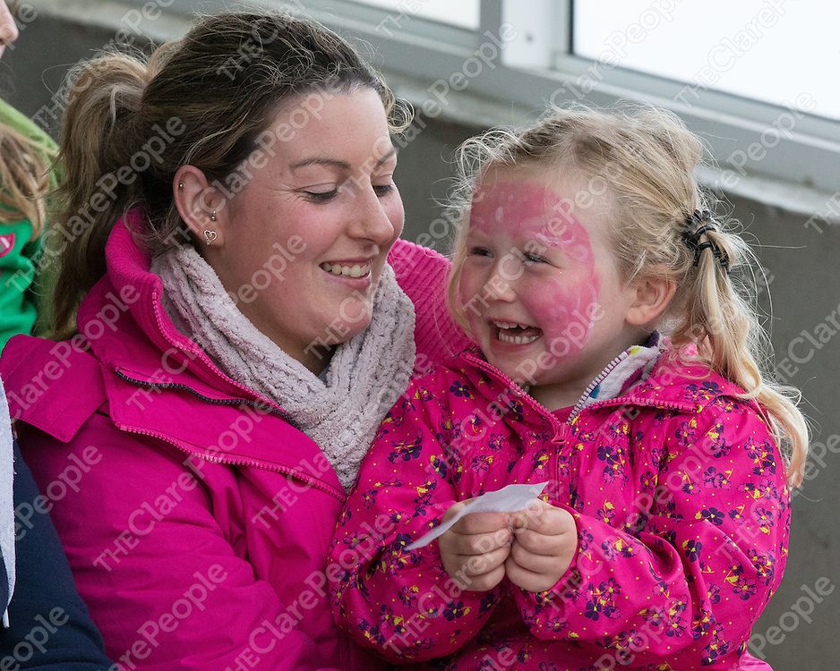 Siofra O'Brien and Amanda Barrington waiting for the pig race at the Kilmihil Festival of Fun Pig Racing 2015