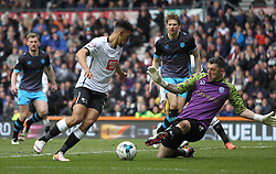 Nick Blackman of Derby County (L) has a shot saved by Keiren Westwood of Sheffield Wednesday - Mandatory by-line: Jack Phillips/JMP - 23/04/2016 - FOOTBALL - iPro Stadium - Derby, England - Derby County v Sheffield Wednesday - Sky Bet Championship
