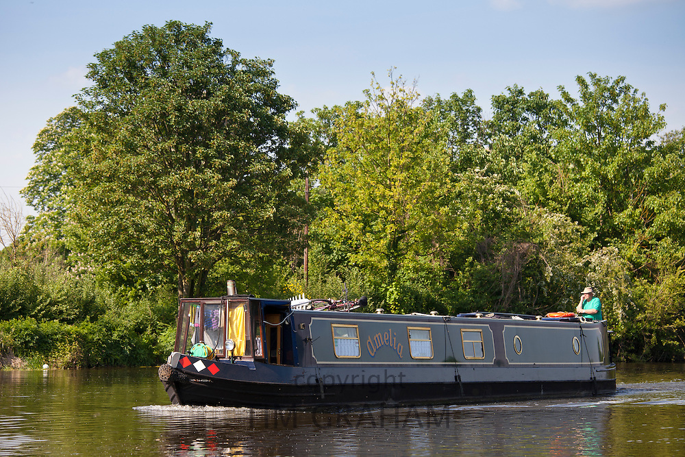 Narrow boat pleasure cruiser on River Thames in Berkshire, UK